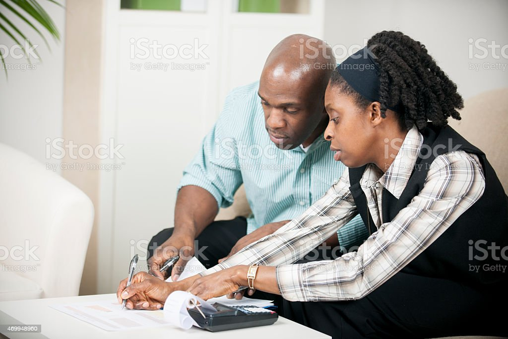 Husband and Wife going over Bills stock photo