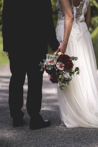 Husband and wife holding bouquet stock photo