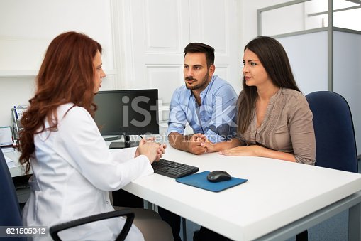 istock Husband and wife in a clinic 621505042