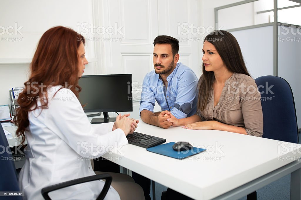Husband and wife in a clinic stock photo