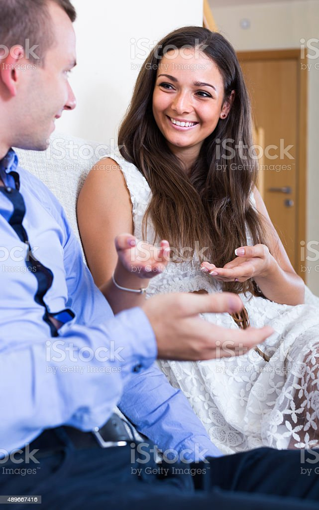husband and wife joking about something at home stock photo