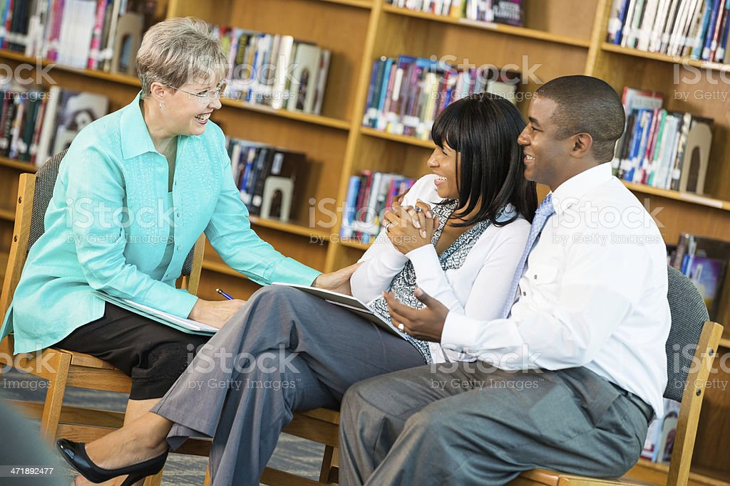 Husband and wife meeting with senior marriage counselor royalty-free stock photo