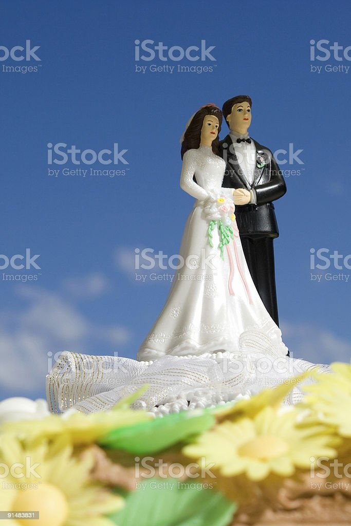 Husband and Wife on a Wedding Cake, Blue Sky royalty-free stock photo