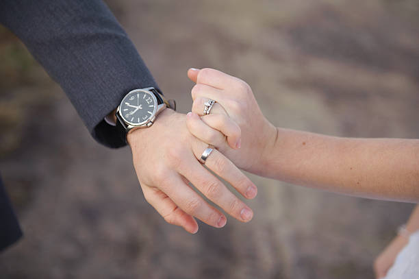 husband and wife on wedding day - pinky promise stock photos and pictures
