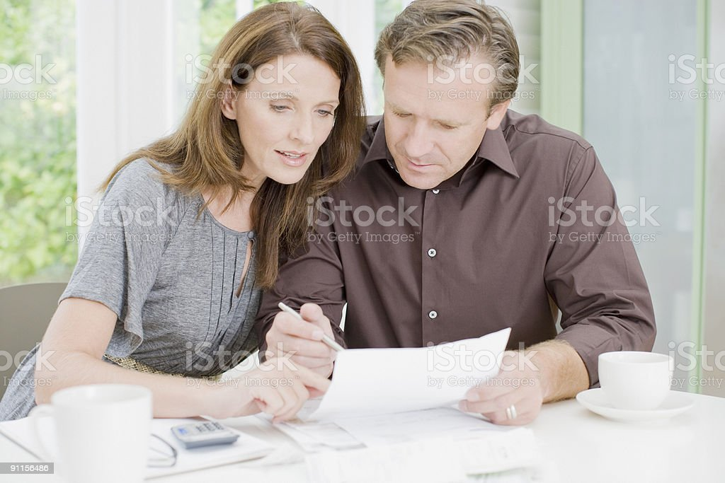 Husband and wife paying bills royalty-free stock photo