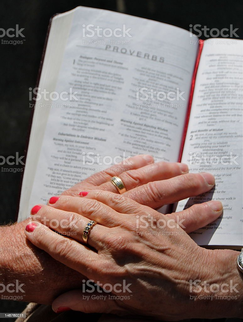 Husband and wife praying royalty-free stock photo
