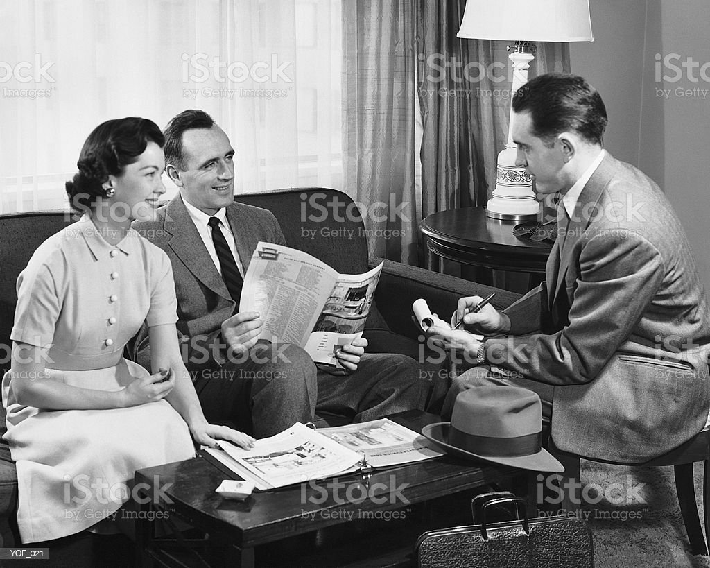 Husband and wife talking to salesman 免版稅 stock photo