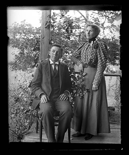 Husband and Wife Victorian-era Portrait Beautiful Black and White portrait of an married couple wearing Victorian-era clothing. Taken on the front porch of their farmhouse dressed in their best clothes. The image was digitally restored from a glass plate taken circa 1890. 1890 stock pictures, royalty-free photos & images