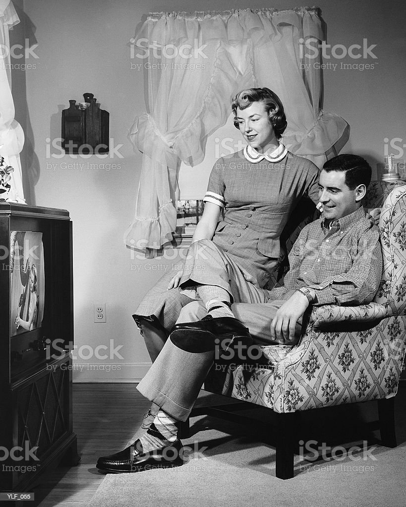 Husband and wife watching television royalty-free stock photo