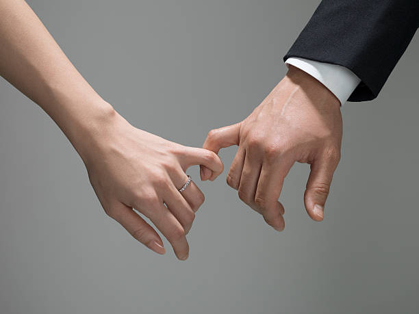 husband and wife who seem to be fortunate - pinky promise stock photos and pictures