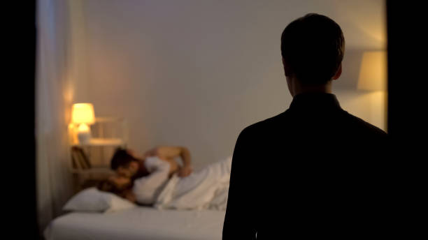 Husband catching his wife cheating with lover in bed, finding out adultery Husband catching his wife cheating with lover in bed, finding out adultery deceitful stock pictures, royalty-free photos & images