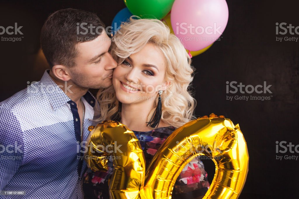 Husband congratulates his wife on her birthday. Man and woman at a...