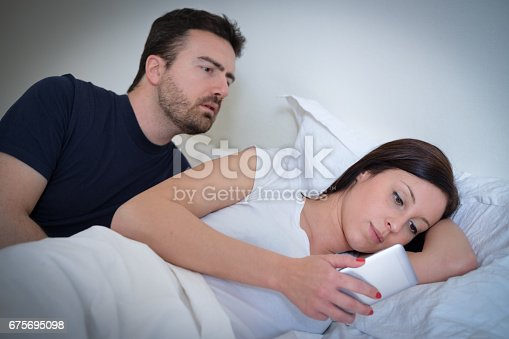 660634310 istock photo Husband discovering the treachery of his wife 675695098