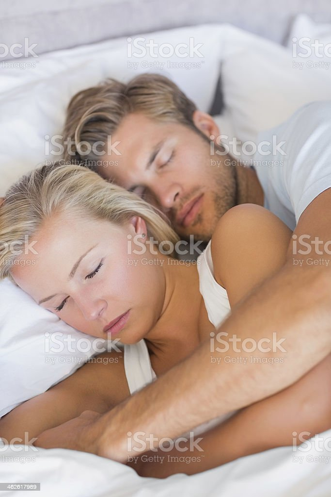 Husband embracing his wife stock photo
