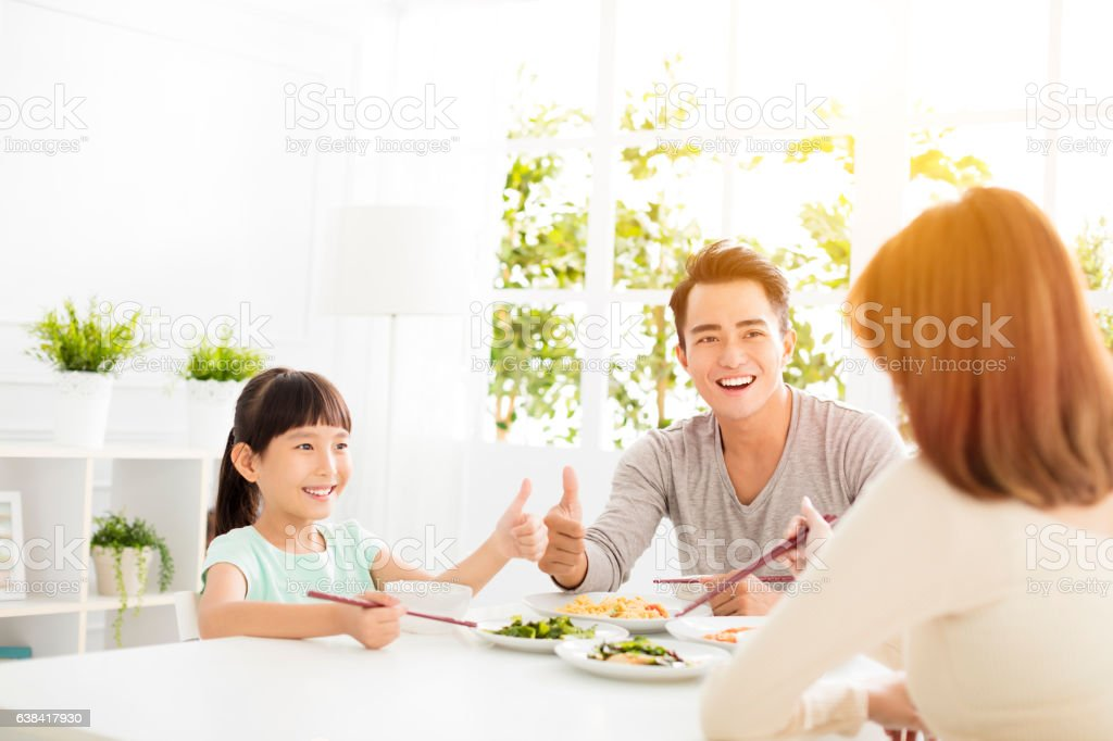 husband gives his wife  thumbs up for the delicious dinner stock photo