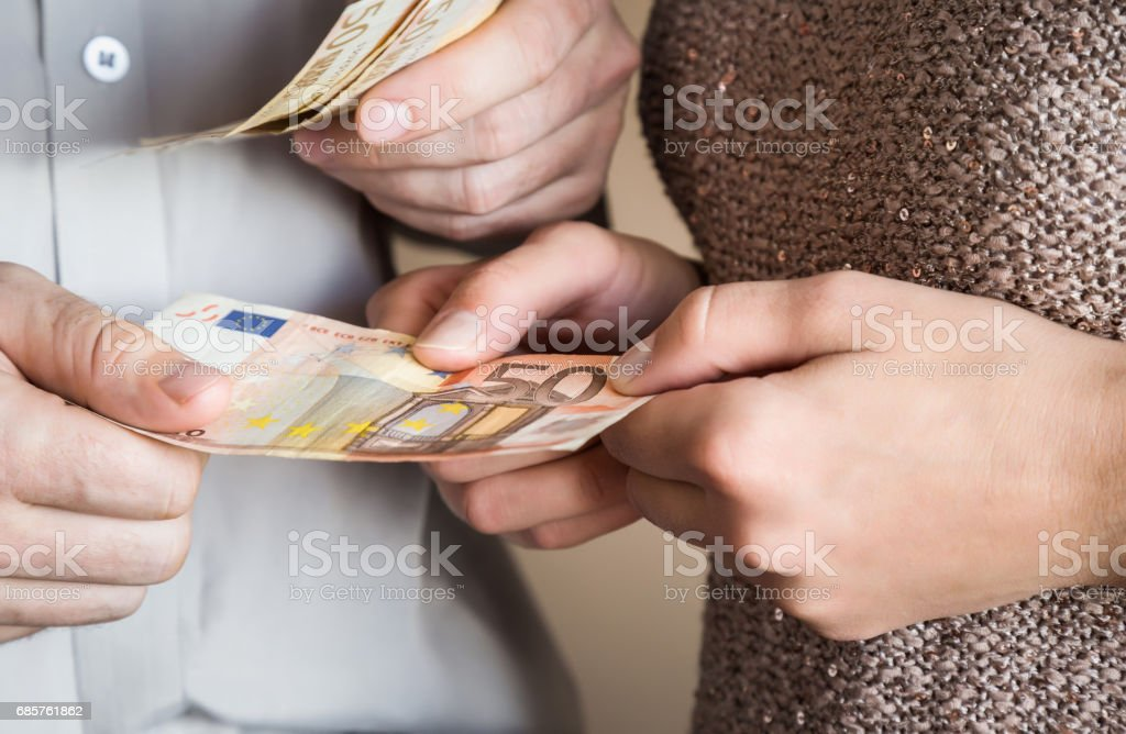 Husband gives to his wife a money for shopping. Euro banknote. zbiór zdjęć royalty-free