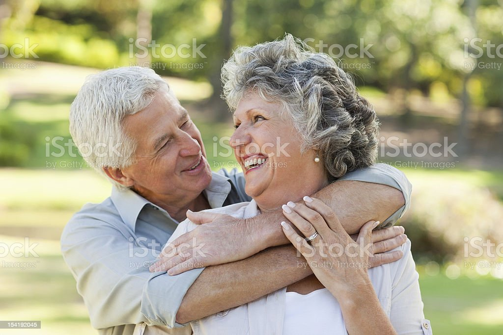Husband hugging his wife and both looking at each other royalty-free stock photo
