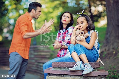 1166996797 istock photo Husband is arguing with wife at the front of their little daughter 819381964
