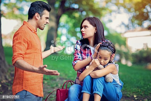 1166996797 istock photo Husband is arguing with wife at the front of their little daughter 819422282