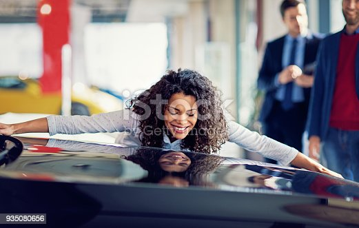 istock Husband is surprising his wife with a new car 935080656
