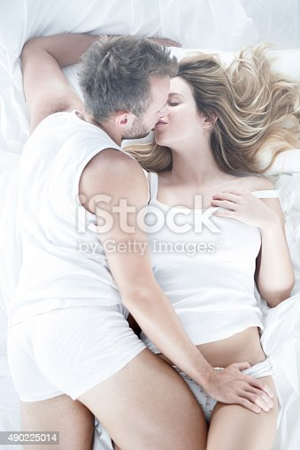 istock Husband kissing and touching wife 490225014