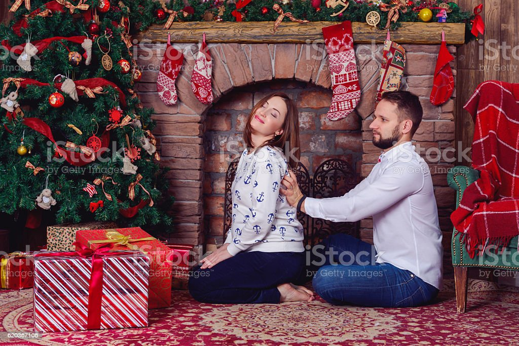 Husband massage for his pregnant wife who suffered shoulder pain zbiór zdjęć royalty-free