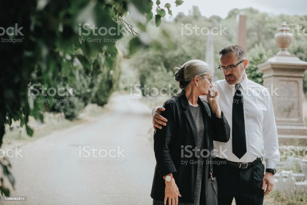 Husband trying to comfort his wife due to her loss stock photo