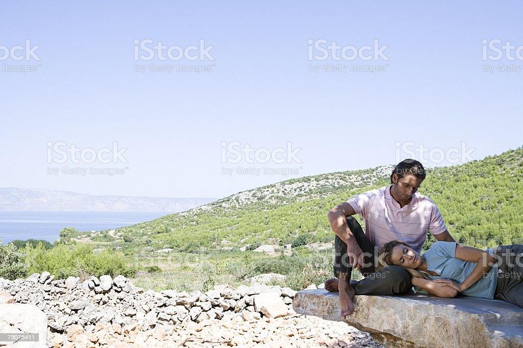 Husband watching over sleeping wife stock photo