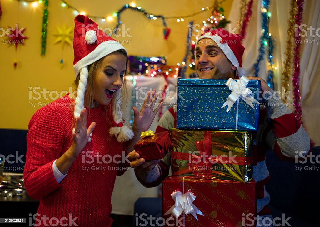husband with gifts surprised his happy wife happy new year royalty free stock