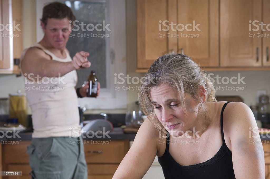 Husband yelling at wife representing verbal domestic abuse stock photo