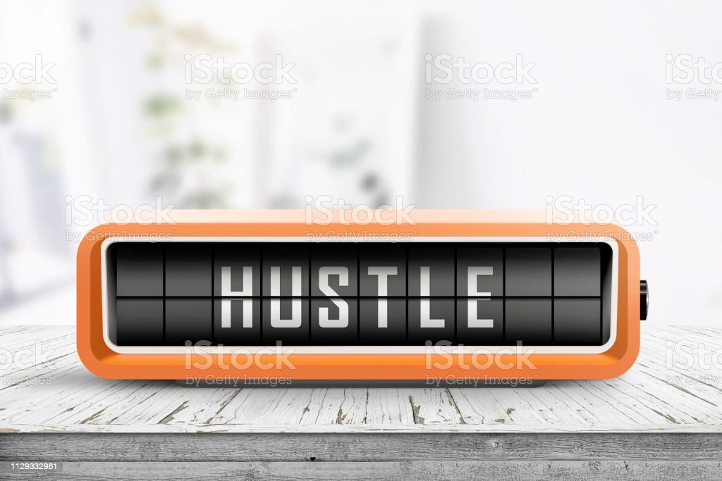 Hustle alarm on a wooden table in a bright room stock photo