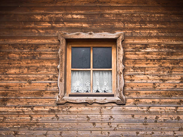 hut and window with curtain stock photo