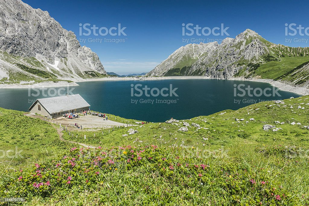 hut at lake in the mountains royalty-free stock photo