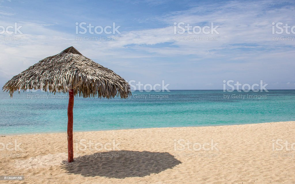 Hut in paradisiac white sand and lonely beach stock photo
