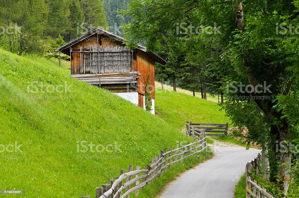 Hut in the Alps on the way stock photo