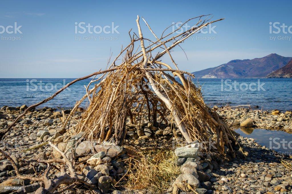 A hut of drifting wood stock photo