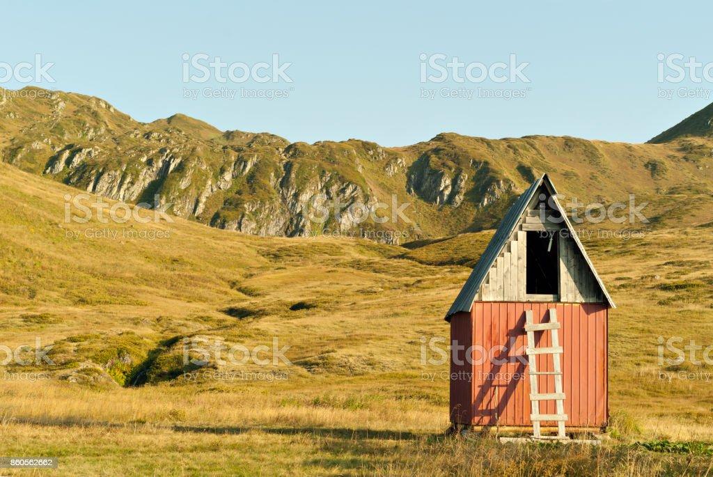 hut on a mountain plateau stock photo