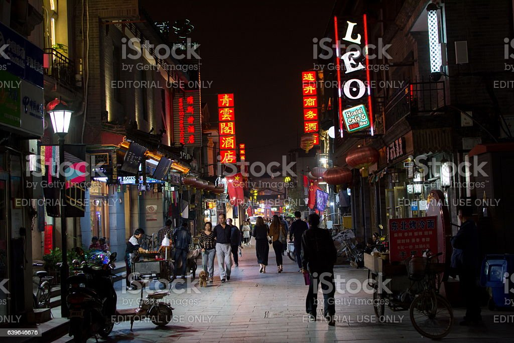 Hutong street night view with people walking stock photo