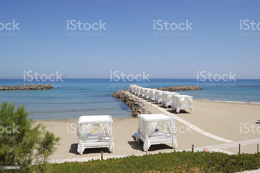 Huts at the beach of luxury hotel, Crete, Greece royalty-free stock photo