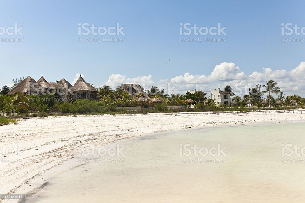 Huts on the Beach stock photo