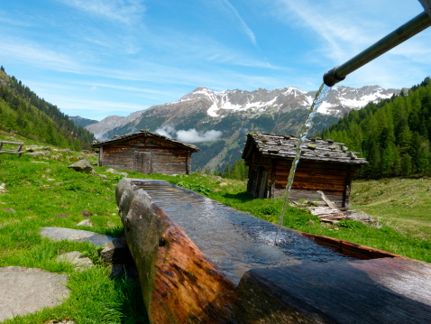 Huts with wooden well