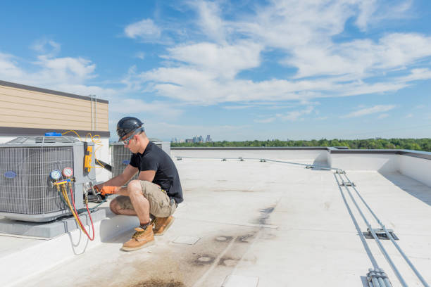 Hvac Tech checking Condenser with Blue Sky Background Hvac technician working on an air conditioning unit with lots of open space technician stock pictures, royalty-free photos & images