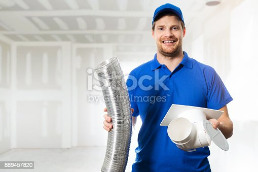 895571294 istock photo hvac technician ready to install ventilation system in house 889457820