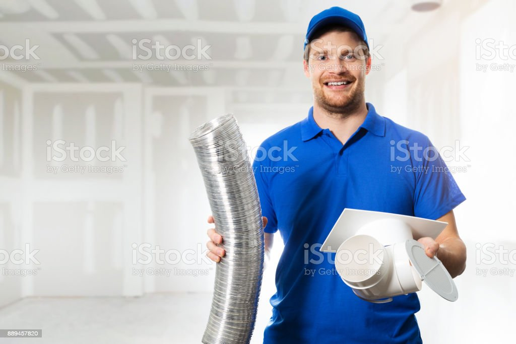 hvac technician ready to install ventilation system in house stock photo