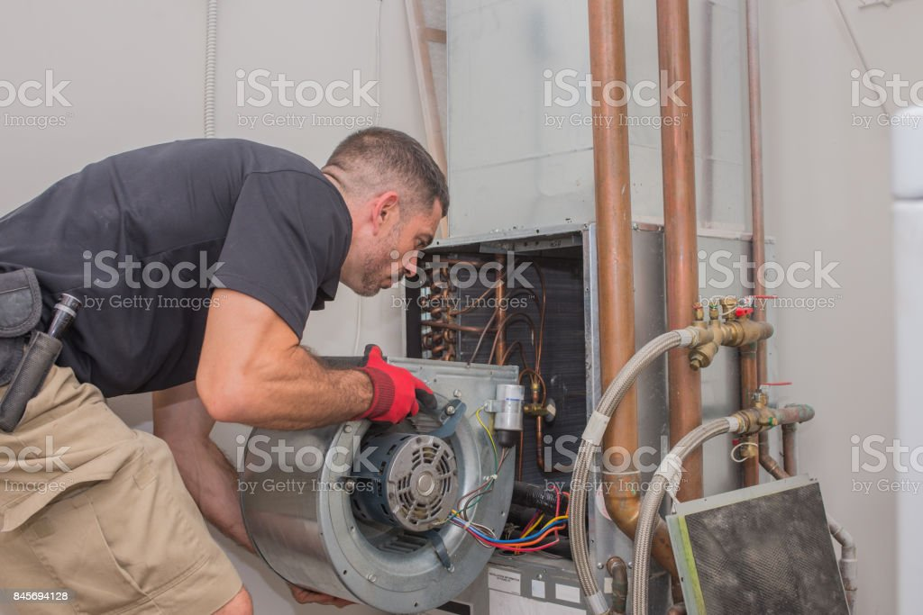 Hvac technician with Motor stock photo