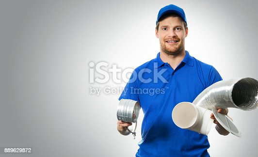 895571294 istock photo hvac worker with ventilation system equipment in hands on gray background 889629872