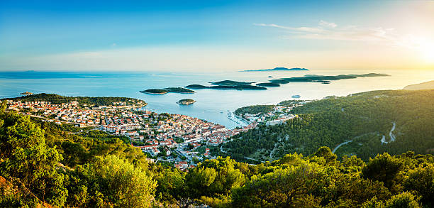 Hvar town on Hvar island, Croatia Hvar town on Hvar island with Pakleni islands, Dalmatia, Croatia at sunset. High resolution image, stitched from several Sony a7R II, photos. taken on mobile device stock pictures, royalty-free photos & images