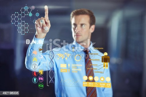 Cropped shot of a handsome young businessman using a digital interfacehttp://195.154.178.81/DATA/shoots/ic_783308.jpg