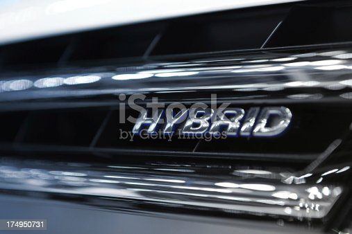 Hybrid Word Written on car grill filtered to chrome and blue cold colors..Car Related Images..