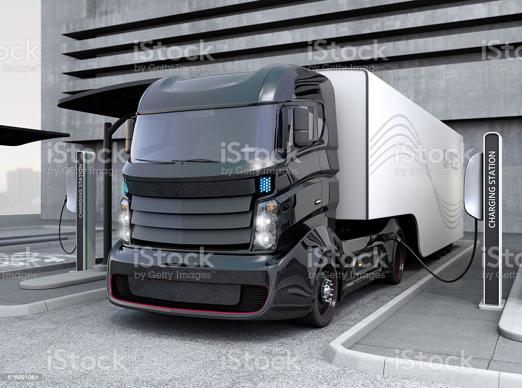 Hybrid electric truck being charging at charging station Hybrid electric truck being charging at charging station. 3D rendering image. Alternative Fuel Vehicle Stock Photo